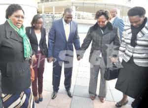 WE PRAY: MP Joyce Emanikor, Ruto?s daughter June, DP William Ruto, MP Hellen Chepkwony and Kenyan Ambassador Makena Muchiri outside the ICC yesterday. PICTURE REBECCA NDUKU/DPPS
