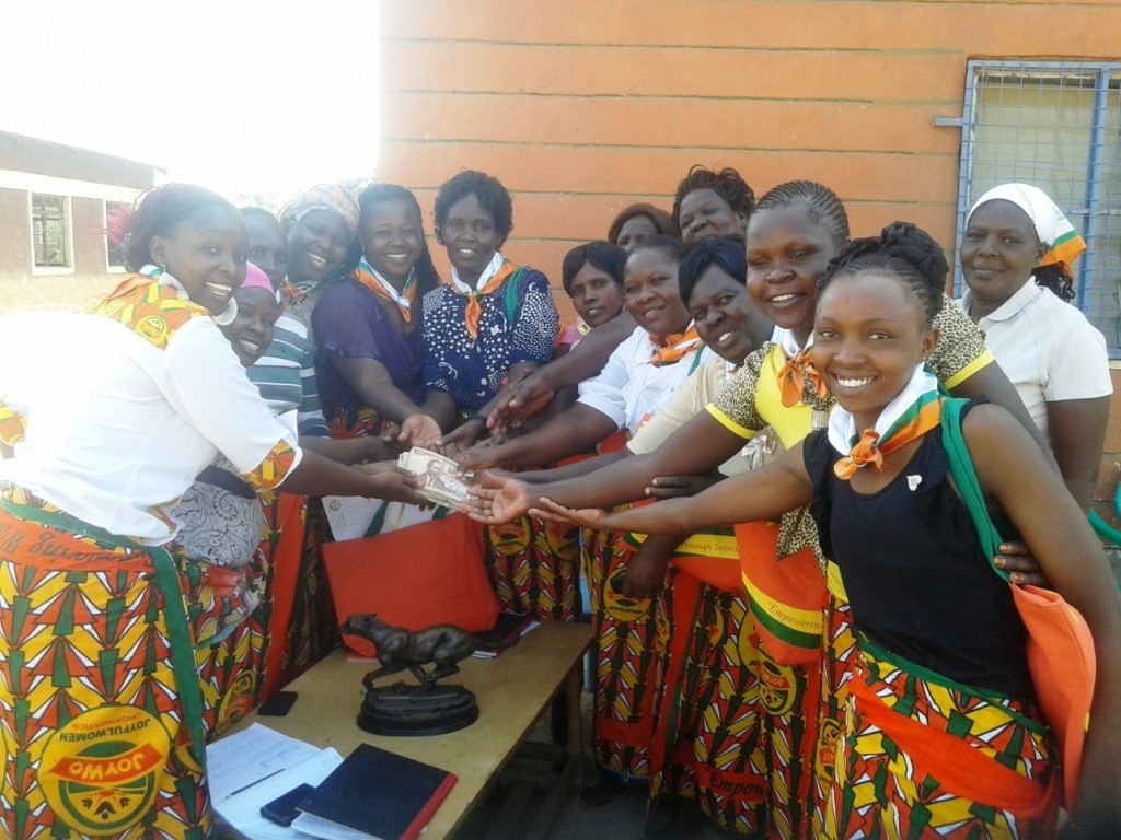 Elshadai Women Group in Lodwar receiving a top up loan to share a total of Ksh. 464,000.00