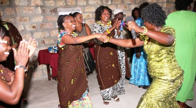 Turkana women dance with excitement to welcome table banking initiative