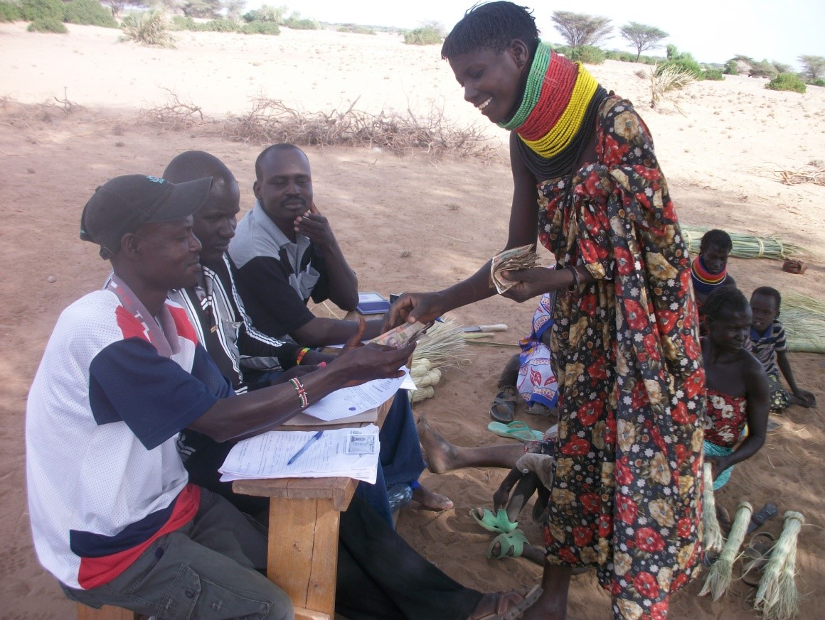 Programme Officer Samuel Nasak facilitates table banking sessions for Lokitoliwo group in Township ward, Turkana Central Sub County